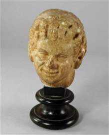 A Roman carved marble head of a faun, possibly c.