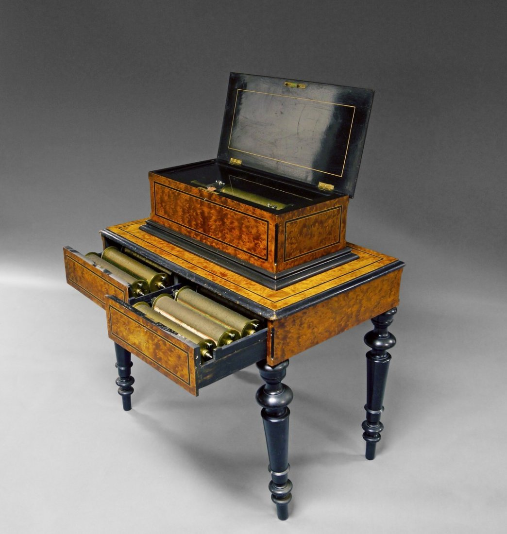 A Swiss amboyna and ebonised free standing music box,