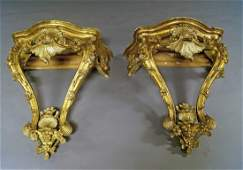 A pair of French Louis XV style giltwood marble topped