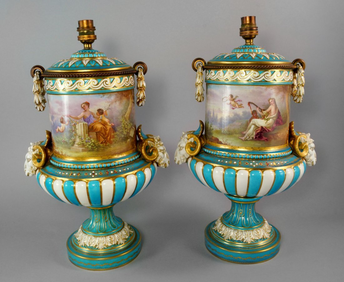 A pair of French gilded and enamelled porcelain and