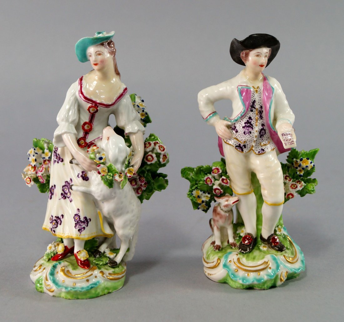 A pair of Derby figures of a shepherd and shepherdess,
