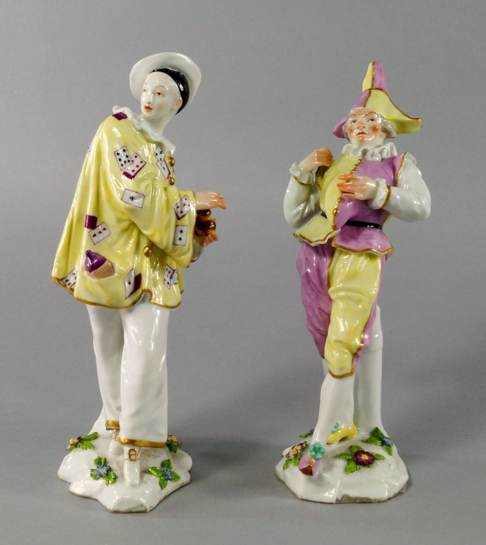 Two Continental porcelain models of Punchinello and