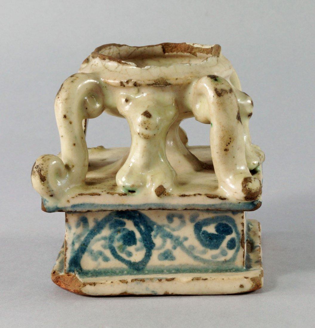 An Italian maiolica salt, probably 17th century, of urn
