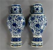 A pair of Chinese porcelain vase shaped wall pockets