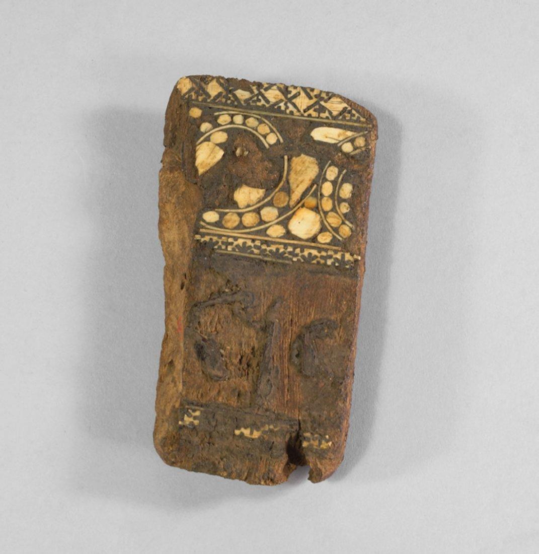 A Fatimid ivory inlaid wood fragment, Egypt, circa 12th