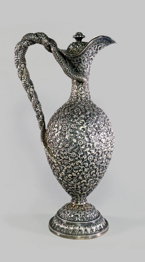 A Kutch repoussé silver claret jug, Gujarat, late 19th