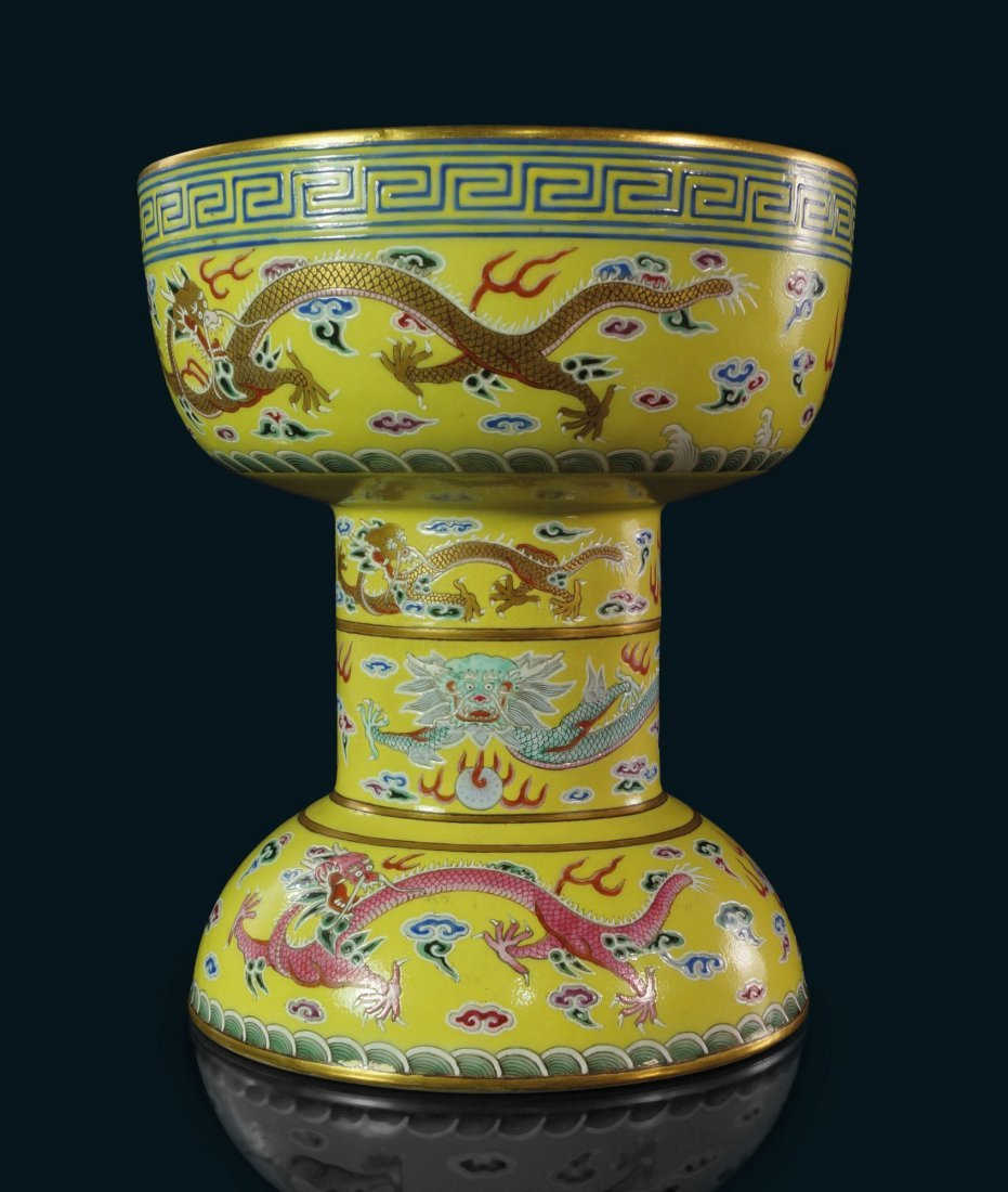 An Imperial Chinese porcelain altar vessel (dou), iron