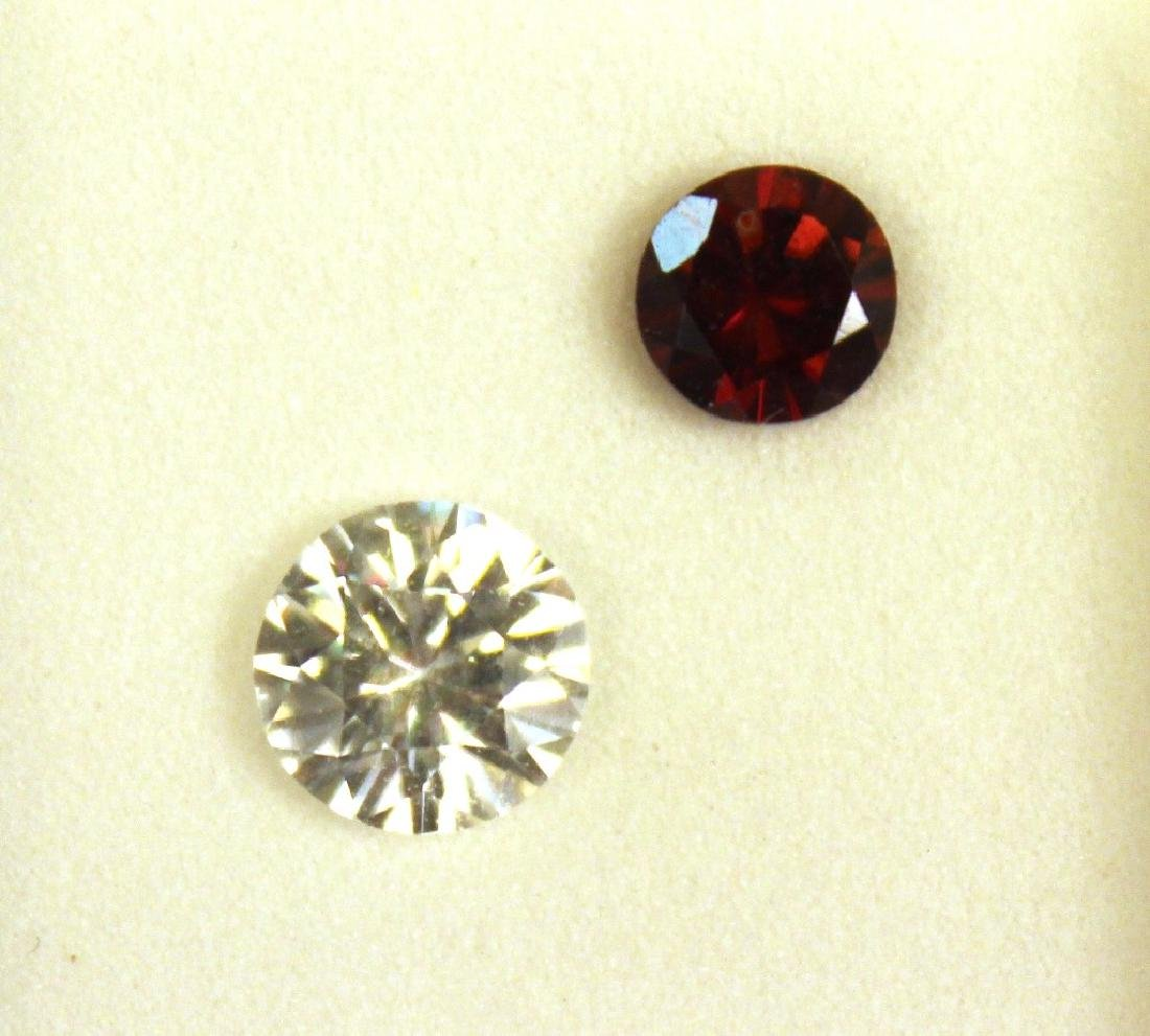 1.50 CT MIN 7.5MM White Zircon, .90 CT 6MM Red Zir