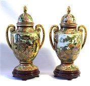 Pair of lidded porcelain vases on bases