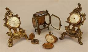 Four Elgin pocket watches and beveled glass box