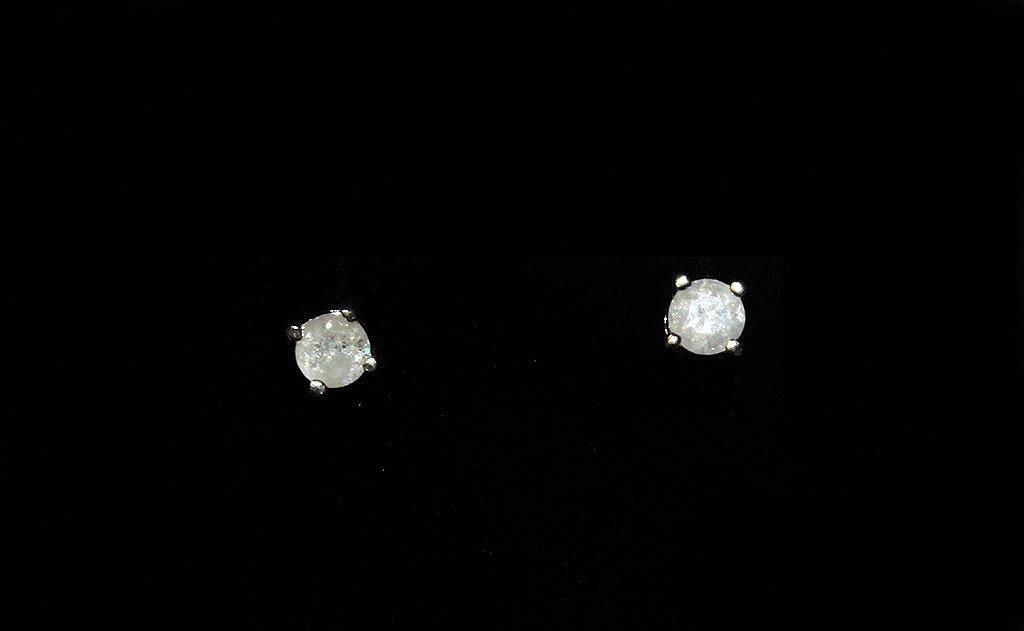 ½ ct. diamond solitaire earrings