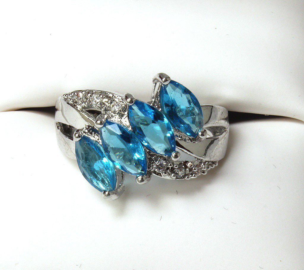 4 stone blue topaz evening ring set in SS