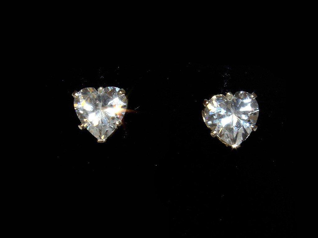 Heart shape cut white sapphire dinner earrings