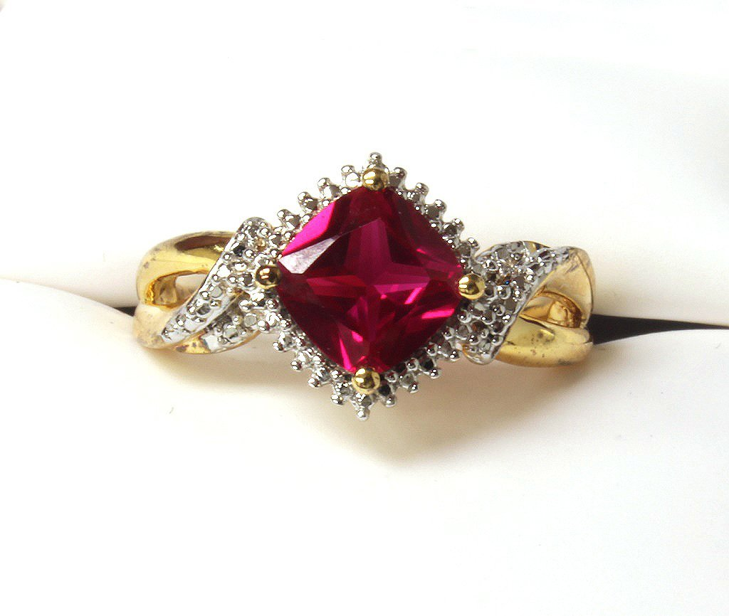 Ruby and diamond ring set in sterling silver