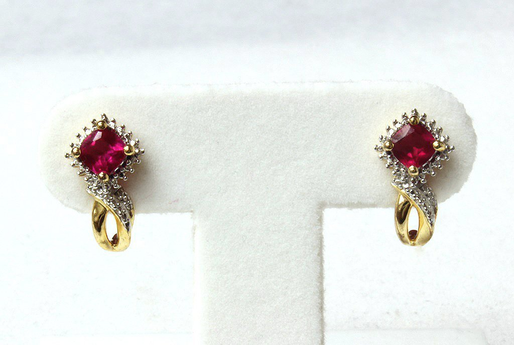 Ruby and diamond earrings set in sterling silver