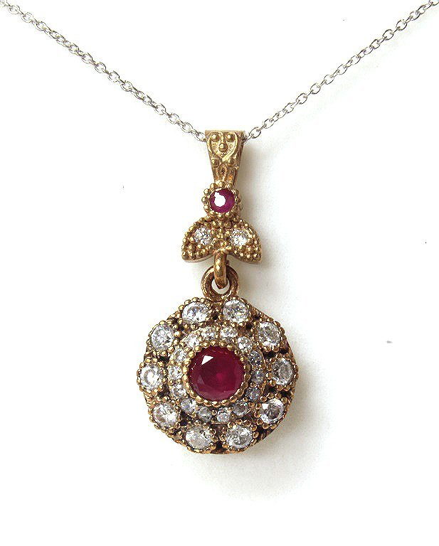 Genuine ruby necklace set in sterling silver.