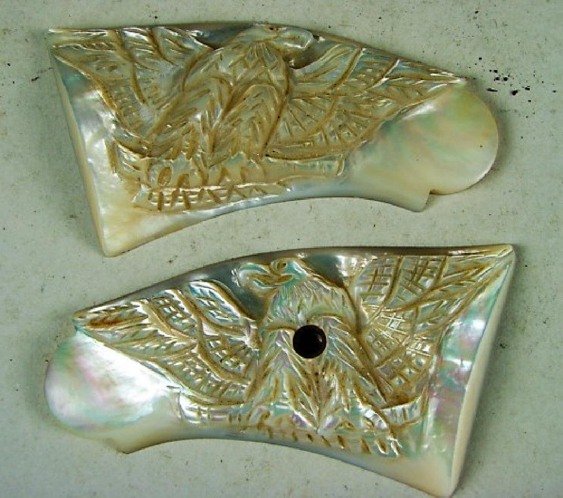 Pair of Carved Mother of Pearl Eagle Grips