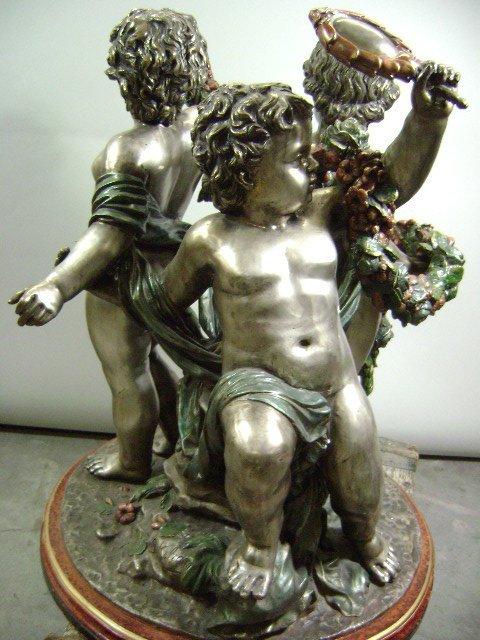 99: Cherub Statue