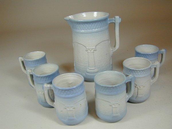 423: Stoneware Pitcher and Mugs