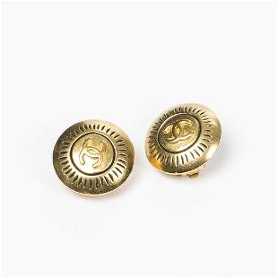 Chanel Round Logo Clip Earrings with line holes