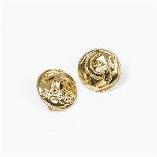 Chanel Round Reverse Embossed Logo Clip Earrings
