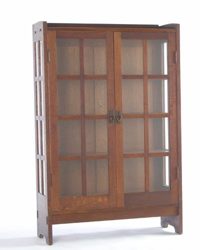 15: GUSTAV STICKLEY Two-door china cabinet with eight p
