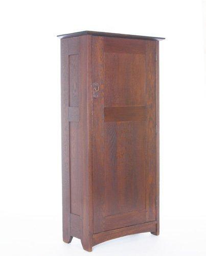 18: GUSTAV STICKLEY Wardrobe with a single, paneled doo