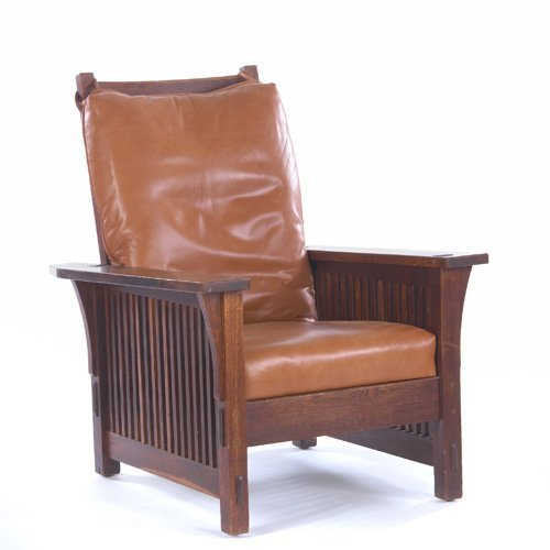 19: GUSTAV STICKLEY Spindled Morris chair with corbels