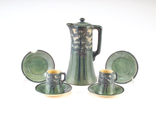 20: NEWCOMB COLLEGE Fine and early chocolate set carved