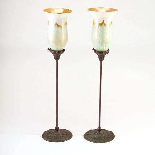 905: TIFFANY STUDIOS/QUEZAL Pair of tall bronze candles