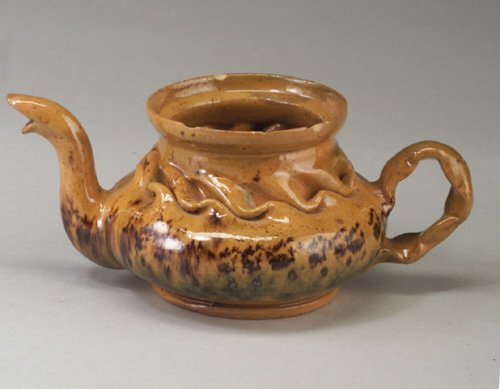 12: Fine and rare GEORGE OHR teapot with crin