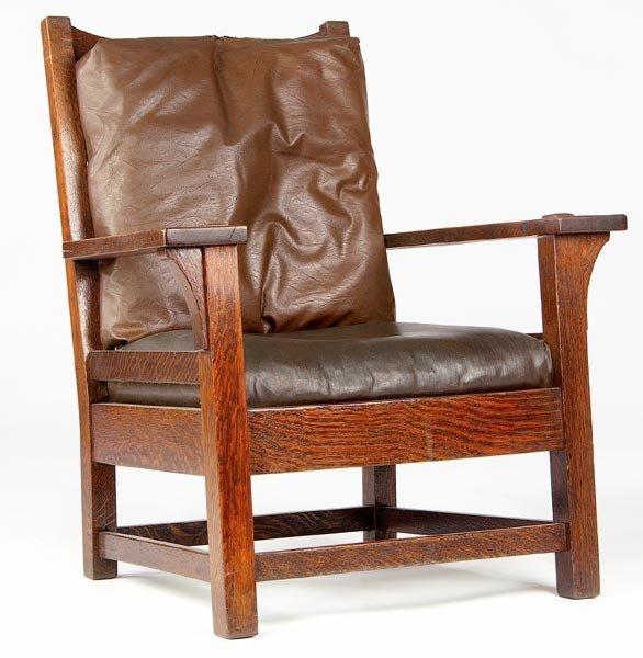 44: GUSTAV STICKLEY Oversized ladderback armchair