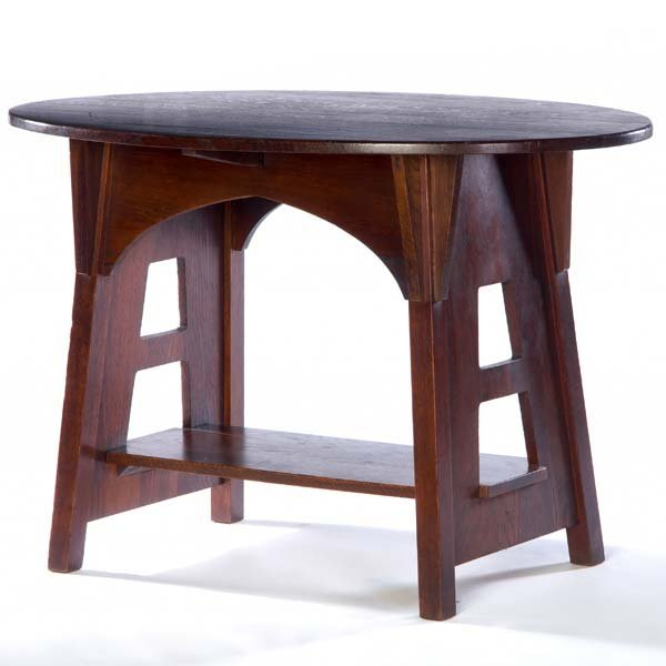 512: LIMBERT Oval cut-out library table (no. 146). Bran