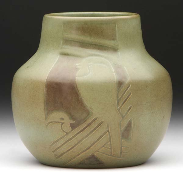 21: OVERBECK Bulbous vase excised with panels of styliz