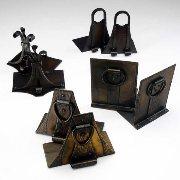 512: ROYCROFT Four pairs of hammered copper bookends