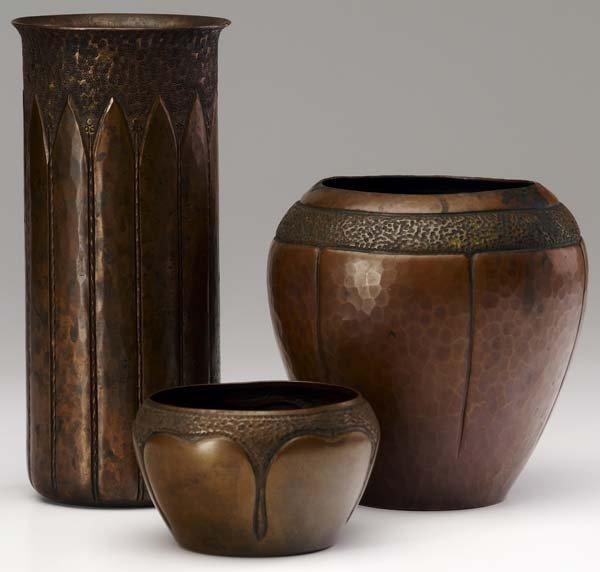 513: ROYCROFT Three hammered copper vessels