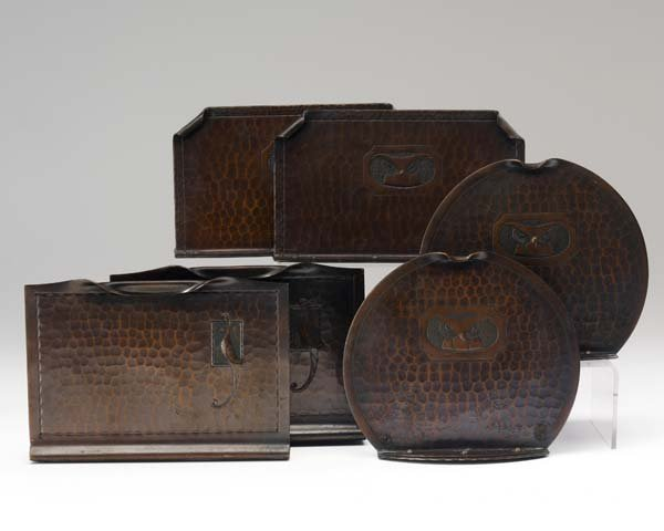 515: ROYCROFT Three pairs of hammered copper bookends