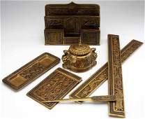 927: TIFFANY STUDIOS Gilt bronze and enamel seven-piece