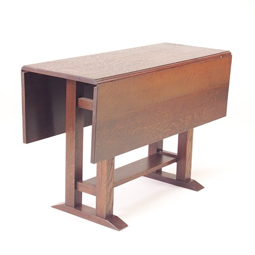 505: GUSTAV STICKLEY Drop-leaf table with shoe feet and