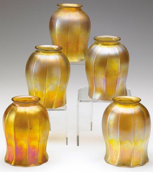 960: TIFFANY STUDIOS Five gold Favrile glass shades