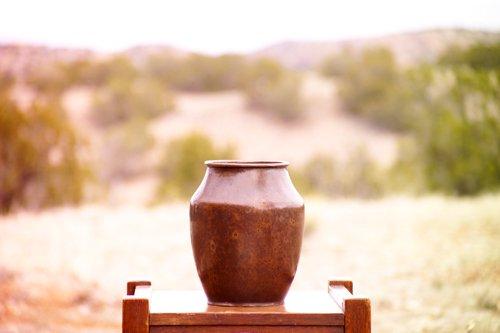 13: DIRK VAN ERP Hammered copper vase with tapering sho