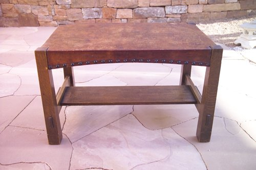 18: GUSTAV STICKLEY Early library table with a tacked-o
