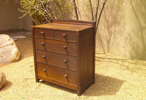 24: GUSTAV STICKLEY Early chest of drawers in two-over-