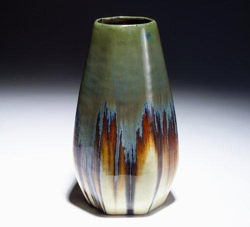 521: FULPER Faceted vase covered in mottled green and b