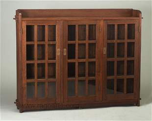 475: Fine ONONDAGA SHOPS three-door bookcase