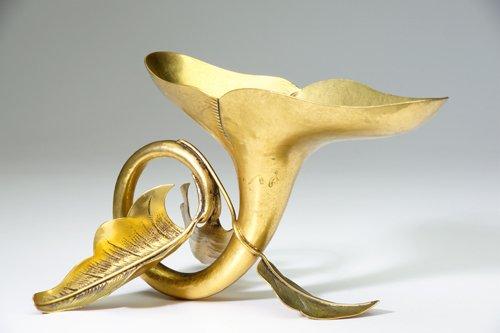 6: MARIE ZIMMERMANN Cornucopia-shaped vase in hammered,