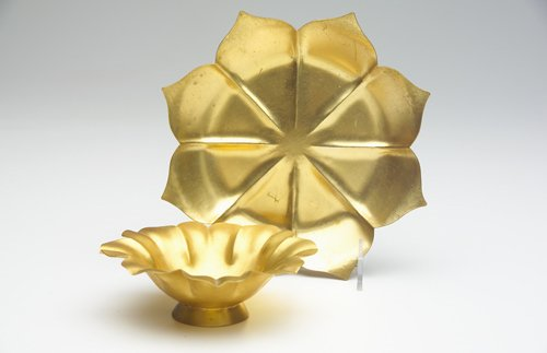 13: MARIE ZIMMERMANN Two fluted flower-form dishes in g