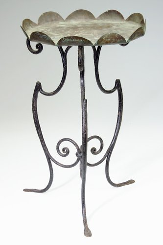 19: MARIE ZIMMERMANN Garden table in wrought iron and c