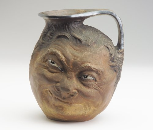 219: MARTIN BROTHERS Large double stoneware face jug in - 2