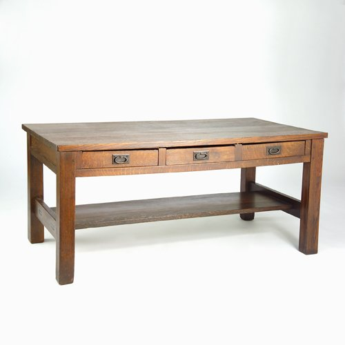 502: GUSTAV STICKLEY Three-drawer library table with ov